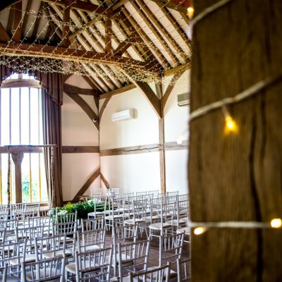 Cain Manor, professional wedding lighting, beams wrapped in fairylights
