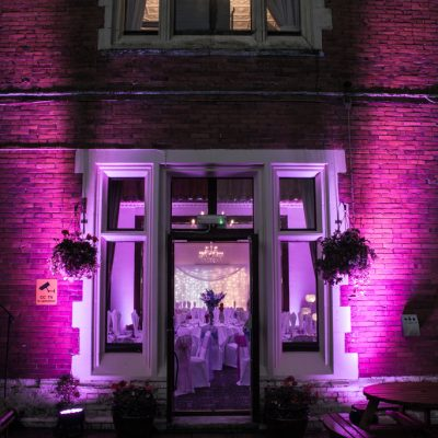 Highley Manor, professional wedding lighting, patio entrance in purple